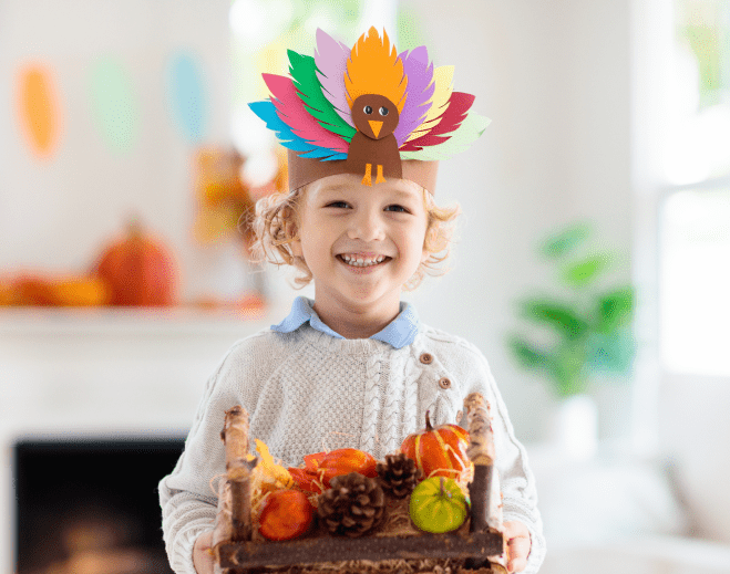 child with a turkey hat on