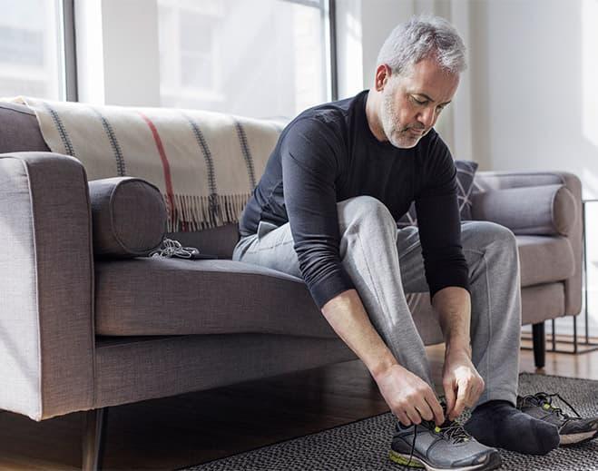 Man tying sneakers