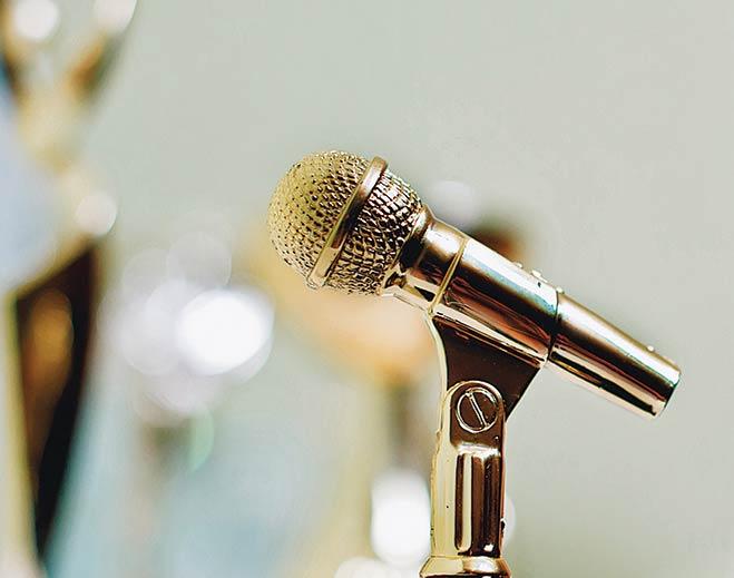 award-gold-mircophone-standing
