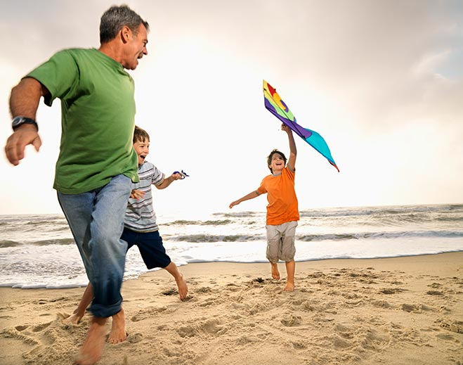 father-sons-beach